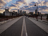 Straight down the middle (Jim Nix / Nomadic Pursuits) Tags: travel bridge sunset skyline river photography downtown cityscape minneapolis olympus mississippiriver mn goldenhour omd em1 stonearchbridge mirrorless nomadicpursuits jimnix olympusomdem1