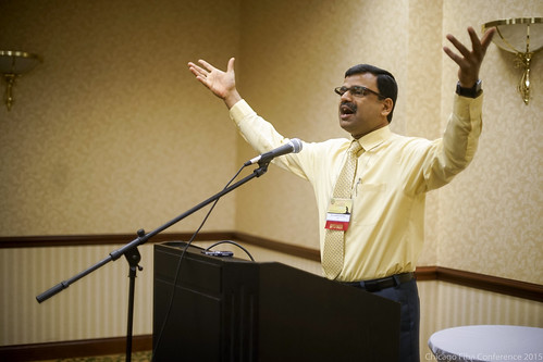 George Mathew speaking to youth