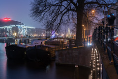 Winter Lights (McQuaide Photography) Tags: amsterdam noordholland northholland netherlands nederland holland dutch europe sony a7rii ilce7rm2 alpha mirrorless 55mm primelens prime sonnar sonyzeiss zeiss fe55mmf18za fullframe mcquaidephotography adobe photoshop lightroom tripod manfrotto light licht availablelight night nightphotography water longexposure stad city capitalcity urban river amstel rivier waterside lowlight outdoor outside waterfront architecture skyline building gebouw cityscape winter amsterdamlightfestival magerebrug skinnybridge royaltheatrecarré carré boat houseboat boot woonboot christmas kerst festive