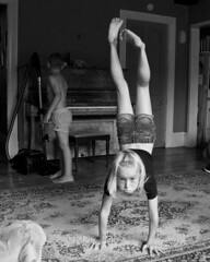 Lounge Gymnastics 25 copy (C & R Driver-Burgess) Tags: boys girl shaved forehead blonde curly hair young small headstand spider walkover monochrome playing kids children