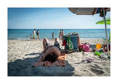 senza titolo (chiara baragatti) Tags: morning light sea summer sky people dog holiday man beach water umbrella relax landscape chair colours shadows orizzonte