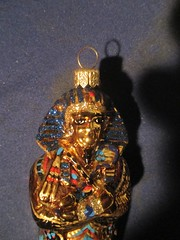 King Tut Egyptian Christmas Ornament 9021 (Brechtbug) Tags: king tut egyptian christmas ornament from mummy sarcophagus case gold ghost glass holiday ball mirror red blue house tree trees display profile snow face portrait with reflection lights holidays decoration decorations decor ornaments night lites light oversize load balls xmas santa claus st nick saint nicholas
