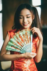 DSC00526 (Spyrosis) Tags: woman portrait fashion female asian model cute beauty chinese new year red qipao dress lomography achromat