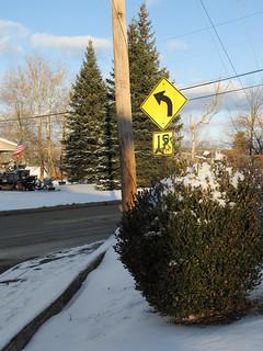 Snowy scene of speed avisory.