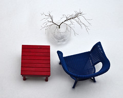 Snow day (James_D_Images) Tags: still life snow red table blue chair potted tree bare branches