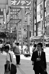 Through the ads of Akihabara (Thorsten Reiprich) Tags: street city summer people urban blackandwhite man travelling sunshine electric japan modern town asia day capital business commercial   akiba electronic kanto tokio  honshu chiyoda               akibagahara
