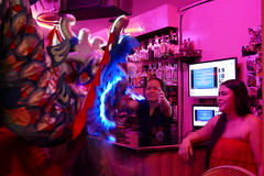 Dragon gets a big New Year's hug from the bartender - Bangkok (ashabot) Tags: lunarnewyear bangkok thailand bangkokstreetscene peopleoftheworld dragon night nightshots nightlights nightlife internationalcities travel seetheworld