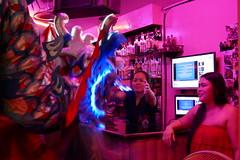 Dragon gets a big New Year's hug from the bartender - Bangkok (ashabot) Tags: lunarnewyear bangkok thailand bangkokstreetscene peopleoftheworld dragon night nightshots nightlights nightlife internationalcities travel seetheworld