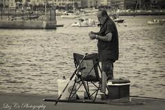 pescador aguilas (luzcramos) Tags: blackandwhitemaniac pescador aguilas murcia bw blancoynegro fotografiablancoynegro fotografiadocumental aire libre mar serenidad black white blackwhite