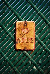No Parkring (peterszeles1) Tags: rust red orange yellow green blue metal sign pattern lines diagonal rectangle square white decay contrast composition fence brown center simple nikon d3000