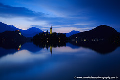 Dawn breaks over Lake Bled (Ian Middleton: Photography) Tags: morning travel trees summer vacation cliff moon lake holiday mountains alps reflection building tower castle history tourism church water beautiful architecture clouds religious island dawn still julian scenery europe european bell famous scenic eu tourist tourists architectural historic crescent christian clear slovenia alpine touristy stunning bled backdrop former christianity popular fortress defense defence hilltop yugoslavia attraction shimmering eec clifftop waning slovenian slovene gorenjska slavic