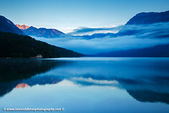 Morning at Lake Bohinj in Slovenia (Ian Middleton: Photography) Tags: park morning travel summer vacation mist lake holiday mountains alps reflection tourism beautiful misty landscape julian scenery europe european mood moody famous scenic eu tourist clear slovenia alpine national valley stunning former popular resorts picturesque region bohinj yugoslavia attraction triglav slovenian slovene gorenjska