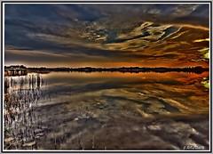 La luz abrazando el paisaje. (Jose Roldan Garcia) Tags: atardecer aire agua colores contraluz reflejos cielo nubes natural naturaleza laguna luz libertad libre toledo