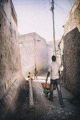 Through the Walled City of Harar (departing(YYZ)) Tags: africa street city travel people kids zeiss work 35mm children ancient sony ethiopia a7 walled walledcity eastafrica harar sonnartfe35mmf28za