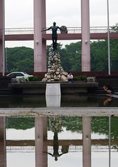July 22 / rain (Fred Dabu) Tags: reflection wet up rain statue philippines diliman oblation qc quezoncity universityofthephilippines oble walkingintherain