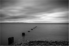 Stepping Out (andihun65) Tags: longexposure sea blackandwhite beach mono whitstable seasalter moodysky canon60d bw10stopndfilter canon1585mmis