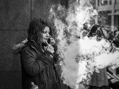 Making The Weather (Leanne Boulton) Tags: monochrome outdoor urban street candid portrait portraiture streetphotography candidstreetphotography candidportrait streetlife woman female girl face facial expression makeup look emotion feeling mobile phone smoke smoker ecig vape vapour vaping cloud tone texture detail clarity depthoffield bokeh natural light shade shadow city scene human life living humanity people society culture canon 5d canon5dmkiii black white blackwhite bw mono blackandwhite glasgow scotland uk