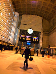 on time and in place (Ian Muttoo) Tags: img20161206180951edit toronto ontario canada gimp unionstation greathall walk walking handheld motionblur renovation construction clock via departures