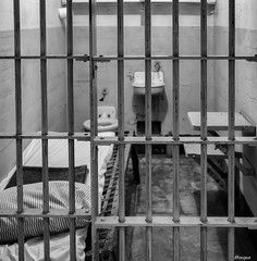Behind bars (moniquevantorenburg) Tags: alcatraz bars tralies cel sanfrancisco alcatrazisland california unitedstates verenigdestaten blackandwhite zwartwit mono monochrome bed roadtrip m43 mft microfourthirds olympusomdem5markii jail gevangenis