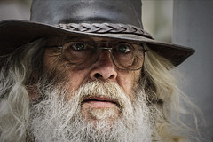 ,-, (dagomir.oniwenko1) Tags: man manwithglasses men male candid canon canoneos60d color street style face portrait person portret people portraits poprtrait humans beard wrinkles ritratto retrato