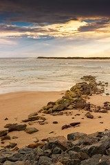 Sun Rays Through The Dark Clouds (k009034) Tags: 500px waves australia bribie island caloundra copy space outdoors pacific queensland tranquil scene beach clouds low tide nature no people ocean rocks sand sea sky travel destinations water teamcanon
