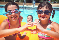 best friends (citygirlny10305) Tags: girls summer pool happy goggles naturallight float bestfriends hearthands cannon5dmarkii