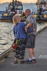 Delightful company (Tom Blankenship Photography) Tags: sunset smiling june canon photography evening washington twilight dock photographer state dusk smiles photographers professional 7d olympia wa 19th oldercouple strolling 2015 portofolympia tomblankenship