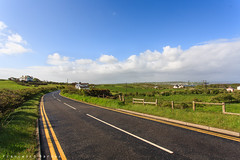 Nothern Ireland roads (Francesco8723) Tags: road uk blue ireland houses sky irish grass lines rain yellow fence countryside path country bluesky line asphalt distillery bushmills cottages wisky nothernireland causeways thegiantcauseways