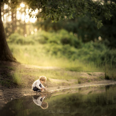 simple (iwona_podlasinska) Tags: light boy sunset reflection cute water childhood outdoors kid child magic