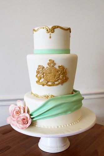 Vintage Gold Family Crest Emblem Wedding Cake
