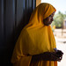 A member of a high school Girls Club waits by the door for their meeting to start in Jigjiga