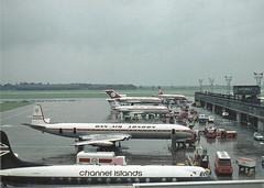 Dan-Air line up, Manchester-Ringway, mid-1970s, plus BEA Viscount (Proplinerman) Tags: airplane aircraft airliner jetliner propliner