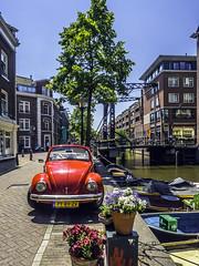 Amsterdam red bug (Tony Tomlin) Tags: flowers amsterdam vw canal beetle volkwagen canalbridge amsterdamcanal convertiblebeetle