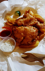 Fish'n'chips to go (Roving I) Tags: fish mahimahi chips fries woodenforks sauces paper newsprint danang dining homedeliveries vietnam vertical