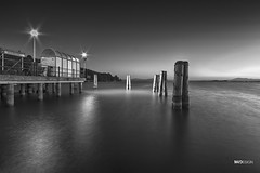 A night in Passignano - Lago Trasimeno (said.matthew) Tags: pier water skyline monochrome blackandwhite trasimeno lago passignano perugia italy sea nature travel peace night longexposure longshutter