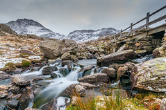 The crossing... (Lee~Harris) Tags: water river bridge rugged mountain mountainrange wales uk colour colours longexposure love snowdonia snow snowcappedmountain britain beautiful naturelovers nature landscapes landscapephotography motion flowing flowingwater nationalpark