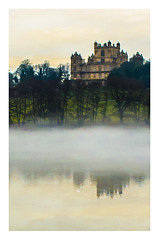 Light on at Wollaton Hall (A.I.D.A.N.) Tags: wollaton wollatonhall lake lakes countryside country notts nottingham nottinghamshire mist misty trees treeline water waterside late afternoon landscape landscapes waterscape reflection dusk border whiteborder canon canon5dmarkii canon5dmkii canoneos5dmarkii mkii markii colour moody sky sundown sunset