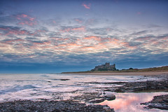 Sunrise at Bamburgh Castle. (paul downing) Tags: pauldowning pd1001 pauldowningphotography nikon d7200 bamburgh northumberland sunrise northsea castle beach hitech gnd 12 filters