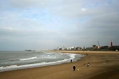 .. a day at the beach (Tomsch) Tags: travel sea sky lighthouse holland beach netherlands clouds canon 350d pier sand travels scheveningen journey niederlande okanddogstoo tomsch