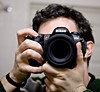Look into my eye... (Ryan Brenizer) Tags: camera nyc newyorkcity portrait selfportrait newyork reflection me lens mirror nikon bokeh manhattan posed ofme 2006 sigma30mmf14dc noflash depthoffield d200 february myapartment carpeicthus sigma30mmf14exdchsm flickr:user=carpeicthus