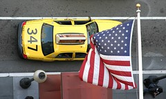 Wednesday Morning, Middle of the Road (Thomas Hawk) Tags: auto sanfrancisco california street city usa car yellow automobile unitedstates 10 flag cab taxi unitedstatesofamerica over americanflag busy american waving unionsquare taxicab 347 fav10