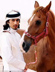 A Love Story (Mohammed Nairooz) Tags: portrait horses horse brown white man male guy history love animal wow model eyes friend gulf desert modeling traditional 2006 arabic clothes story human arab looks actor arabian gcc doha qatar lifetime nairooz thobe nikonstunninggallery