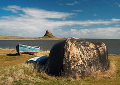 A castle, some boats and a whale (Ray Byrne) Tags: uk sea england sky castle grass clouds rural canon landscape boats 350d bay coast countryside unitedkingdom britain postcard country north northumberland shore canon350d gb whale northern northeast holyisland lindisfarne landscapephotography raybyrne byrneout