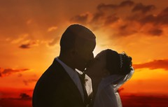 The Afterglow (Studio Antwan) Tags: wedding sunset orange sun love silhouette tag3 taggedout clouds groom bride interestingness kiss tag2 tag1 interestingness1 marraige afterglow interestingness2 interestingness4 interestingness133 myportfoliobest