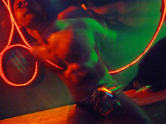 That dance you do (ale2000) Tags: gay light shadow red people orange blur color colour men green club night digital naked fun lights florence moving dance dancing bears fabrik blurred bathed firenze coloured nightclubbing menonly bearbutch e900 favcol specialnight utatafun