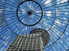 Buildings - Harbour Centre - 1977 (SqueakyMarmot) Tags: blue sky canada glass architecture vancouver clouds pattern cloudy harbour centre