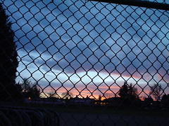 Chain link and sunset (by zak_greant)