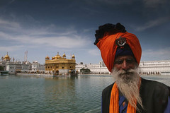 Elderly Nihang Baba at Golden Temple, India (Captain Suresh Sharma) Tags: travel portrait people india lake heritage home water architecture shrine fighter colours tank symbol faith religion oldman divine holy turban sikh punjab gurudwara peopl goldentemple singh headgear seniorcitizen beared panjab