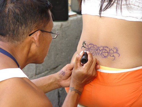 Sexy girl Tinting Her Temporary Tattoo design