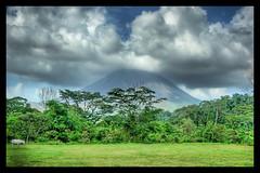 The Unicorn and the Volcano (Stuck in Customs) Tags: travel sky horse cloud clouds landscape volcano nikon costarica d2x unicorn hdr arenal bestshot arenalvolcon fortunaarea d2xs stuckincustoms imagekind treyratcliff stuckincustomsgooglescreensaver